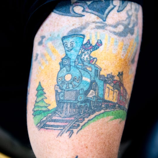 "Cpl. Scott Musselman's most sentimental tattoo is ""The Little Engine That Could."" Musselman's daughter was born 10 weeks early and had to stay in the neonatal intensive care unit. He read the book to her during her stay."