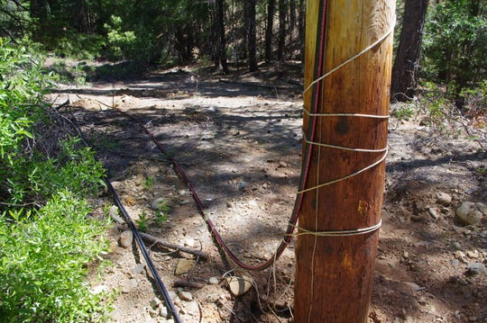The 12,000-volt electrical line that belongs to the Trinity Public Utilities District was tied into an existing overhead electric line in the woods north of Weaverville.