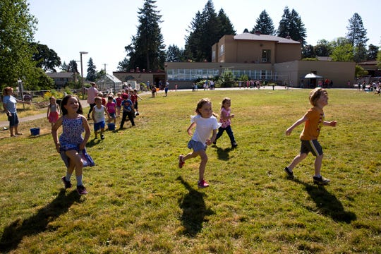 Kindergarteners run towards an activity set up for them during the annual end of the year field day celebration at McKinley Elementary School in Salem on June 12, 2019.