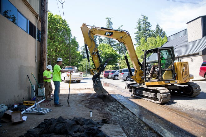 Construction is worked on behind The ARCHES Project in Salem on June 12, 2019. The project is set to be completed in September.