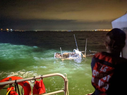 A U.S. Coast Guard crew member from Coast Guard Station Cape Charles, Virginia, observes a submerged vessel in the Chesapeake Bay, June 10, 2019. Soldiers aboard an Army vessel initially found the two survivors in the water after their vessel capsized from foul weather four hours earlier.