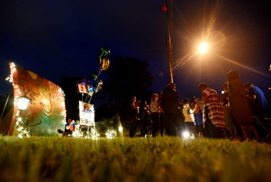 People gather to remember Anthony Childs Tuesday evening, June 11, 2019 at the 5800 block of Kennedy Drive, where he died.