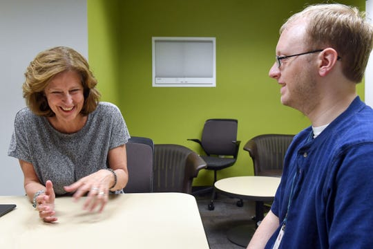 Steven Prendergast talks about his involvement in the Lighting the Way walk for autism awareness with Augustana University special educator Julie Ashworth on Wednesday, June 12, in the Wegner Health Science Information Center.