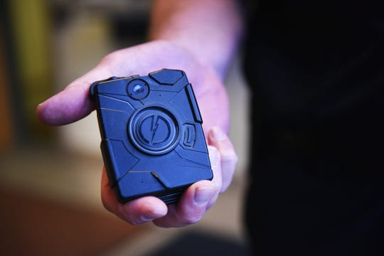Mitchell Assistant Police Chief Michael Koster shows a generation one body camera Tuesday, June 12, 2018 at the police department in Mitchell, South Dakota.