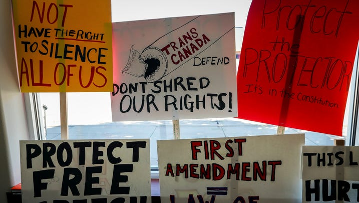 Protest signs are displayed at the NDN Collective, which advocates for indigenous peoples and climate change awareness, in Rapid City on Wednesday, June 12, 2019. (Adam Fondren/Rapid City Journal via AP)