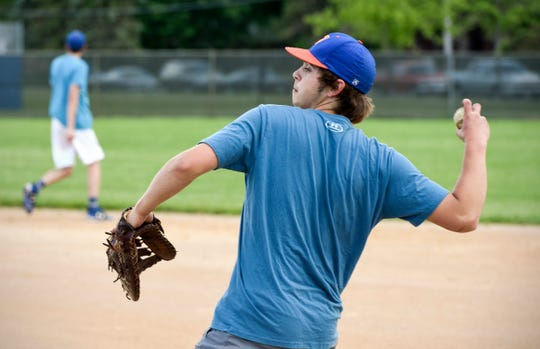 Noah Novak throws the ball from first base during baseball practice Tuesday, June 11, at Foley High School.