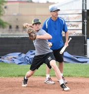 Mark Dierkes throws a runner out at second base during baseball practice Tuesday, June 11, at Foley High School.