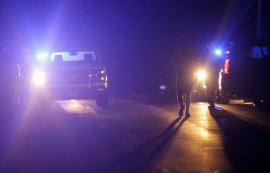 Investigators work the scene of an officer-involved shooting on Tuesday, June 11, 2019, near the junction of County N and State 186 in Arpin, Wis. A Wood County sheriff's deputy was wounded in the arm and flown to a local hospital. Tork Mason/USA TODAY NETWORK-Wisconsin