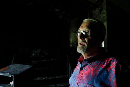 Pastor Bill Petersen stands inside the torched sanctuary of Calvary United Methodist Church in the late night hours of Thursday, May 23 and early morning of Friday, May 24. The State Fire Marshal's Office is investigating the blaze.