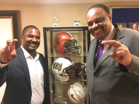 FAMU football head coach Willie Simmons (left) throws up the Rattler fangs with Congressman Al Lawson at the Florida House during his trip to Washington, D.C. on Tuesday, June 11, 2019.