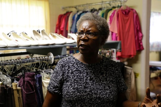 Gwen Dixon, a volunteer with McKenzie's Closet, works to organize clothing inside Wednesday, June 12, 2019.