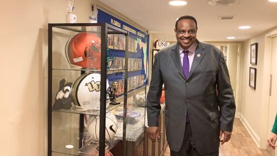 Congressman Al Lawson stands alongside the display of football helmets at the Florida House in Washington D.C. FAMU head coach Willie Simmons presented him with a Rattlers helmet during his visit on Tuesday, June 11, 2019.