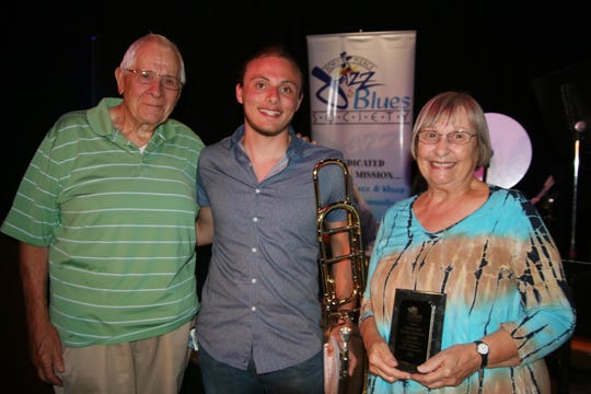 Scholarship recipient Dylan Jampol, center, with Norman and Sandra Stevenson.