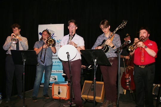 Scholarship recipients Cameron Slack, left, Dylan Jampol, Max Twardowski and Ryan Dillahay jam with Fort Pierce Jazz & Blues Society member and Master of Ceremonies Mark Green at the 2019 Scholarship Awards Night where 10 scholarships were distributed to young musicians pursuing a career in music.