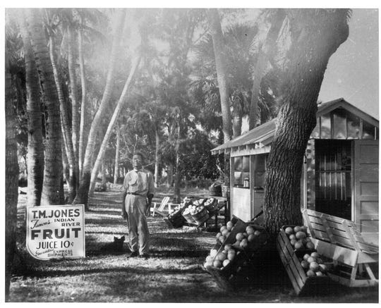 Jungle Trail was the original State Road A1A until 1962. People took it to the Jones family fruit stand, pictured here, that had been operated by Tim Jones (standing) and his son Richard Milton Jones.