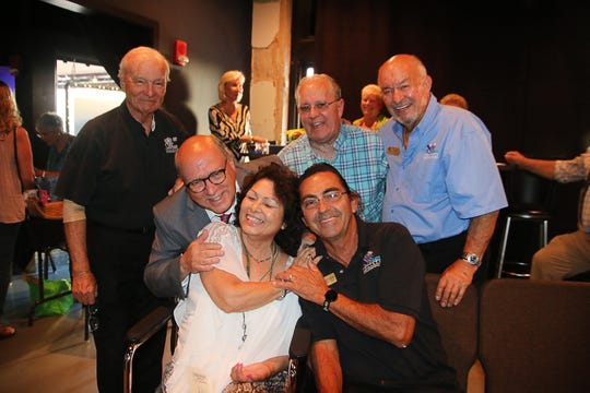 Mia Batalini, seated, center, is greeted after a long absence by fellow musicians Bud Skiles, Claudio Berardi, Max Duhalde, Jimmy Batalini and Jimmy Tucci at the Fort Pierce Jazz & Blues Society's 2019 Scholarship Awards Night.