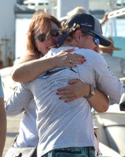 "Gunther Schwartz, 19, of Vero Beach, gets a farewell hug from his mother Kimberly Schwartz, of Fort Pierce, on Wednesday, June 12, 2019, as Gunther prepares to travel to Bimini in the Bahamas, from West Palm Beach, with three of his companions to participate in the Crossing for a Cure stand-up paddle board challenge to raise funds for Cystic Fibrosis. ""I'm doing it for the other CF'ers that aren't able to be here. A year ago I lost a friend to this disease, and I have it, and that was a very traumatizing and scary moment for me, so I promised myself after that, that I'm going to live life to the fullest,"" said Gunther Schwartz. ""I do it for the CF'ers that aren't as fortunate as me, and healthy as me, to give them hope and inspiration to keep fighting."""