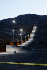 The We Build the Wall border fence is illuminated by lights Tuesday, June 11, 2019, in Sunland Park, N.M.
