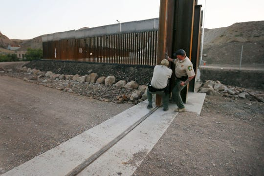 International Boundary and Water Commission guards close the gate at the We Build the Wall fence on Tuesday, June 11, 2019, in Sunland Park, N.M. The International Boundary and Water Commission said that it had requested that the locked gate, which was blocking a levee road in Sunland Park owned by the U.S. government, be opened after it was built without permission. Commission security guards closed the gate Tuesday night but did not lock it.