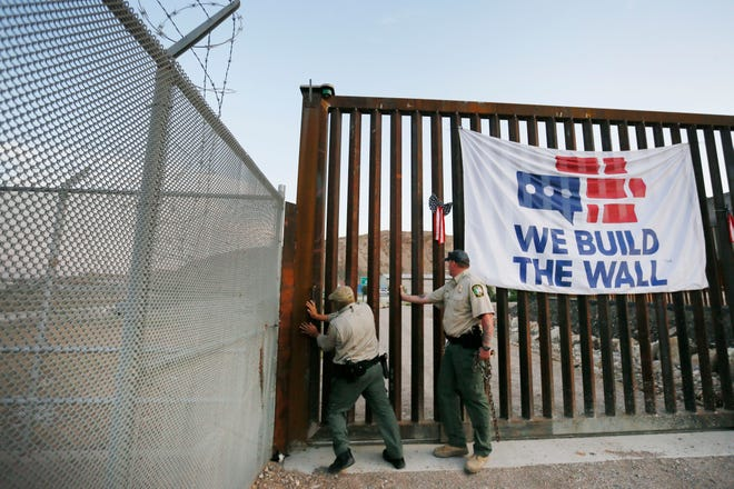International Boundary and Water Commission guards close the gate at We Build the Wall's fence on Tuesday, June 11, 2019, in Sunland Park, N.M.