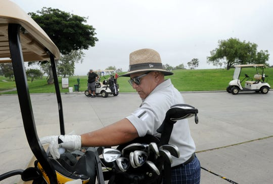 Manny Centeno gets ready to play golf at River Ridge Golf Club in Oxnard.