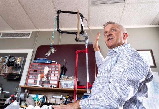 Thomas Cutler, a certified prosthetist orthotist in Visalia,  demonstrates an early demonstration model of the hip on Tuesday, June 11, 2019. Cutler is working on new orthotic solutions.