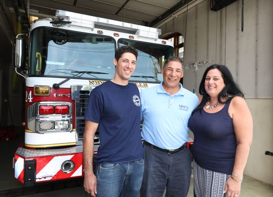"New Rochelle firefighters Ricardo ""Ricky"" Ramos II, his dad, Lt. Ricardo Ramos Sr., and mom Deborah Ramos, are pictured at Fire Station 4 in New Rochelle, June 12, 2019."