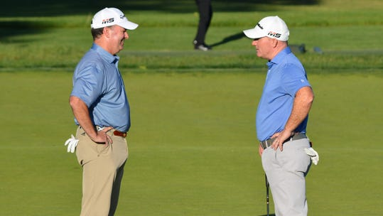 Longtime competitors Greg Bisconti (left) and Frank Bensel chat on the Country Club of Darien putting green before heading out for a two-man playoff to decide the 97th Westchester Open. Bensel captured the championship with a birdie on the first extra hole on June 11, 2019.