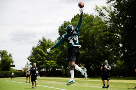 Philadelphia Eagles wide receiver Alshon Jeffery reaches for the ball at the NFL football team's practice facility in Philadelphia, Wednesday, June 12, 2019.