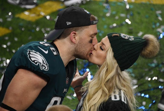 Philadelphia Eagles tight end Zach Ertz (86) kisses Team U.S.A. midfielder and wife Julie Ertz after defeating the New England Patriots in Super Bowl LII at U.S. Bank Stadium, Feb. 8, 2018.