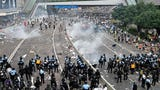 Hong Kong police used tear gas against protesters who oppose a contentious extradition bill. Wednesday's protests delayed a debate over the legislative proposal that would allow criminal suspects to be extradited to mainland China. (June 12)
