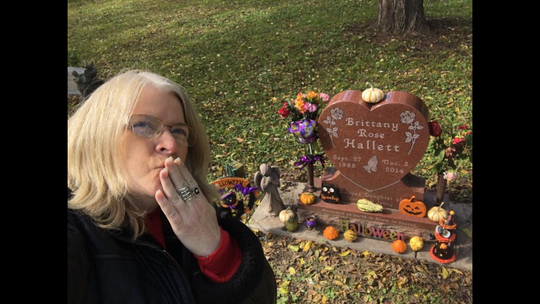 Jenny Hallett is proven on the grave of her daughter, Brittany Rose, whose death used to be alcohol-precipitated.