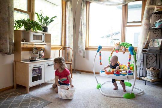 Karli-Rae Kerrschneider's children, Eleanor and Leviathan, play at their home in Baldwin, Wis. (Ackerman + Gruber for Kaiser Health News)