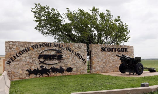 FILE - This June 17, 2014 file photo shows an entrance to Fort Sill near Lawton, Okla. The federal government has chosen the military base in Oklahoma as the location for a new temporary shelter to house migrant children and is considering a customs port in southern New Mexico as another option as existing shelters are overwhelmed. The Office of Refugee Resettlement said Tuesday, June 11, 2019 it's dealing with a dramatic spike in the number of children crossing the border without parents. (AP Photo/Sue Ogrocki, File) ORG XMIT: LA213
