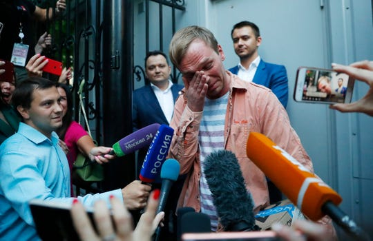 Prominent Russian investigative journalist Ivan Golunov, cries as he leaves a Investigative Committee building in Moscow, Russia June 11, 2019. In a surprising turnaround, Russia's police chief on Tuesday dropped all charges against a prominent investigative reporter whose detention sparked public outrage and promised to go after the police officers who tried to frame the journalist as a drug-dealer.