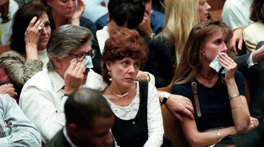 Fred Goldman, father of murder victim Ron Goldman, wipes a tear way as his wife, Patti, and daughter, Kim, listen to the prosecution's closing arguments on Sept. 26, 1995.