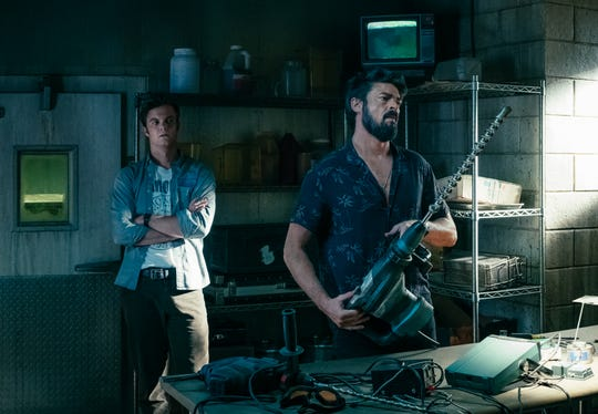 """Jack Quaid, left, takes on compromised superheroes with The Butcher (Karl Urban) in """"The Boys."""""""