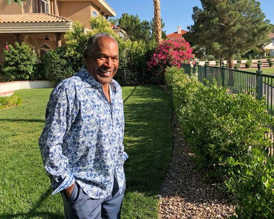 This photo provided by Didier J. Fabien shows O.J. Simpson in the garden of his Las Vegas area home June 3, 2019. After 25 years living under the shadow of one of the nation's most notorious murder cases, Simpson says his life now is fine.