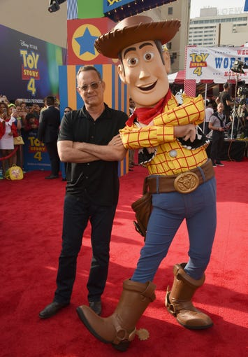 "Tom Hanks, left, poses with his character Woody as he arrives at the world premiere of ""Toy Story 4"" on Tuesday, June 11, 2019, at the El Capitan in Los Angeles. (Photo by Chris Pizzello/Invision/AP) ORG XMIT: CAPM153"