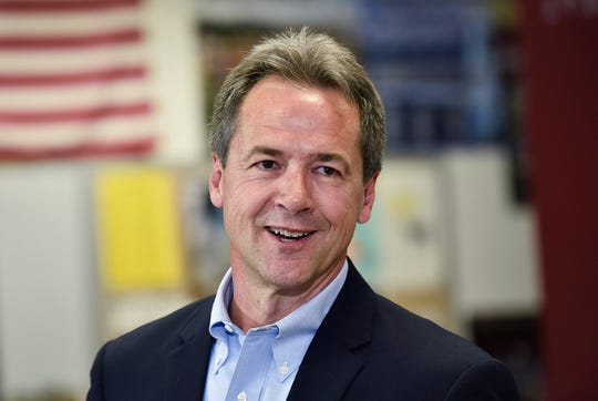 File - In this May 14, 2019, file photo, Montana Gov. Steve Bullock, Democratic presidential candidate, officially announces his campaign for president at Helena High School in Helena, Mont. (Thom Bridge/Independent Record via AP, File) ORG XMIT: MTHEL201