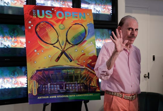 In this June 14, 2017, file photo, artist Peter Max acknowledges applause during the unveiling of the theme art he created for the 2017 U.S. Open tennis tournament in New York. Authorities say Max's wife, Mary, 52, was found dead June 9 in New York amid a family fight over her husband's work. Her death comes two weeks after The New York Times published a story detailing legal battles over the work of Peter Max, a prolific creator of colorful, psychedelic art who is now living with dementia at age 81.