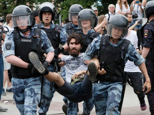 Russian riot police detain a participant of a protest  supporting arrested and now released Meduza's journalist Ivan Golunov suspected in drug keeping and spreading in Moscow, Russia, 12 June 2019. Ivan Golunov, a journalist specialized in corruption cases investigations was arrested by police for drug spreading and later released after a wave of public protests.