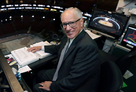 In this May 29, 2019, photo, NBC hockey broadcaster Mike Emrick poses for a photo while preparing to call Game 2 of the NHL hockey Stanley Cup Final between the St. Louis Blues and the Boston Bruins in Boston.