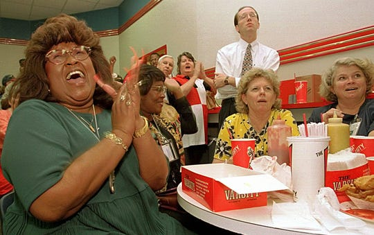 Gail Sullivan, left, reacts with joy after the verdict was announced on television at The Varsity in Atlanta.