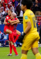 United States forward Alex Morgan (13) celebrates her fifth goal with forward Megan Rapinoe (15) against Thailand during the second half in group stage play during the FIFA Women's World Cup France 2019 at Stade Auguste-Delaune.