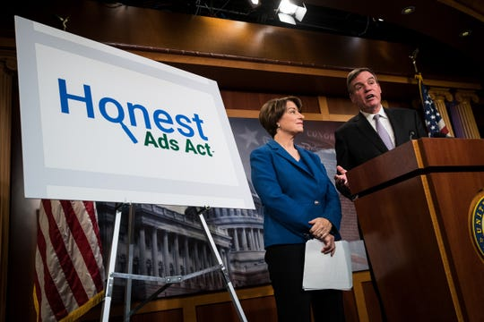 Sens. Amy Klobuchar of Minnesota and Mark Warner of Virginia introduce the Honest Ads Act in 2017.