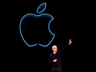 Apple CEO Tim Cook presents the keynote address during Apple's Worldwide Developer Conference (WWDC) in San Jose, California on June 3, 2019.
