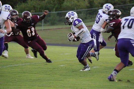 Montgomery running back Mikel Auge (5) picks up yardage against Grant last season.