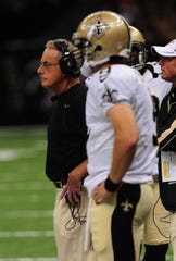 In this file photo, New Orleans Saints interim head coach Joe Vitt and quarterback Drew Brees watch as the defense takes the field against the Jacksonville Jaguars in the preseason game in the Mercedes-Benz Superdome on August 17, 2012.