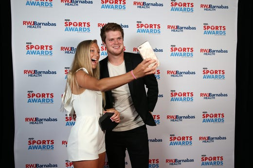 Janie Cowley of Manasquan High School, Girls Lacrosse Player of the Year, poses with New York Jets quarterback Sam Darnold during the Asbury Park Press Sports Awards at Count Basie Center for Arts in Red Bank, NJ Wednesday June 12, 2019.